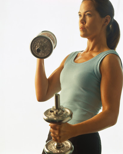 Woman Exercising with Dumbells ca. 2001